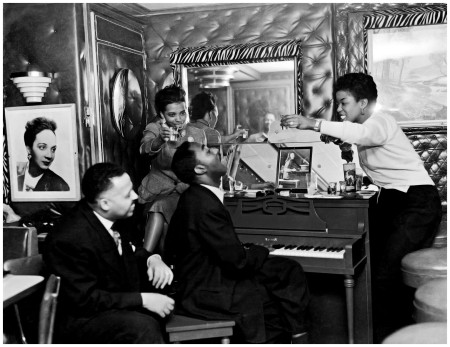 "Photo Charles ""Teenie"" Harris - Frank Bolden at left and Sarah Vaughan at right ith another woman and man at piano,1950 Teenie Harris Archive"