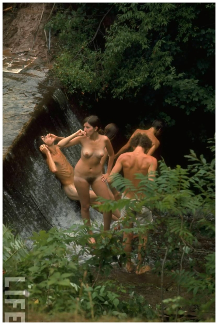 Photo John Dominis Naked men & women bathing in a small waterfall, during the Woodstock Music & Art Fair 1969