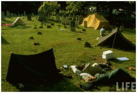 Photo John Dominis Young people camping out w. tents in the midst of a cemetery, during the Woodstock Music & Art Fair 1969