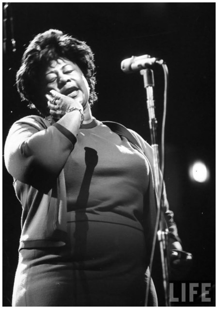 Singer Ella Fitzgerald singing at the Democratic rally for President John F. Kennedy's birthday 1962 NYC Yale Joel
