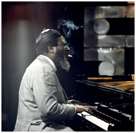 Thelonious Monk Photo David Redfern smoking a cigarette while playing the piano, on the Jazz Scene TV show filmed at Ronnie Scott's Club on April 9th 1970