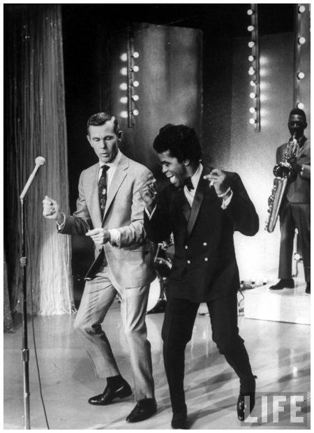 Singer James Brown (R) teaching talk show host Johnny Carson how to dance Arthur Schatz 1967