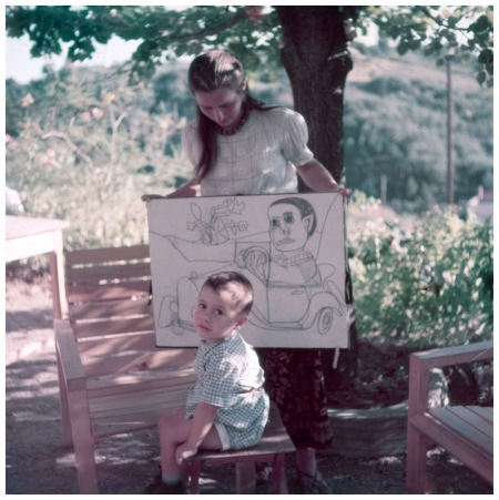 Picasso lover for 10 year with their young son Claude She holds drawings of the boy by Picasso Vallauris France 1949 Photo Gjon Mili