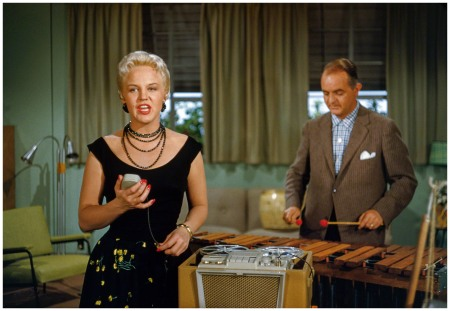 1955. %22Peggy Lee singing into tape recorder accompanied by Sonny Burke. Soundtrack for Walt Disney CinemaScope cartoon feature Lady and the Tramp.%22 35mm Kodachrome by Robert Vose for Look magazine