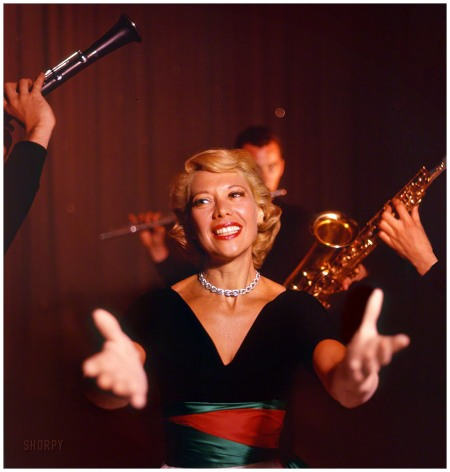 October 1955. %22Singer Dinah Shore on the set of her television show.%22 Color transparency from photos by Earl Theisen and Robert Vose for the Look magazine assignment %22Dinah Goes Glamorous.
