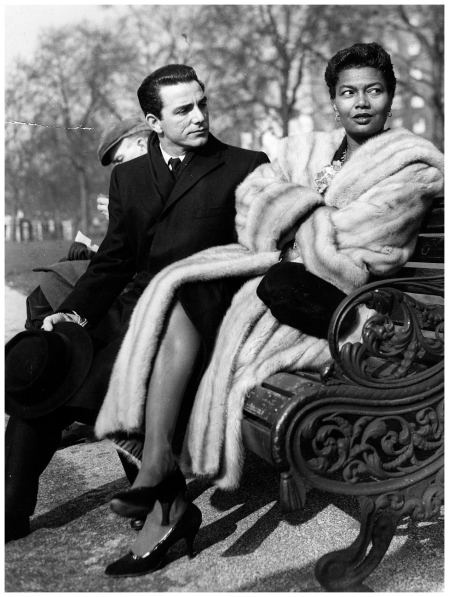 Louie Bellson and wife Pearl Bailey on a park bench